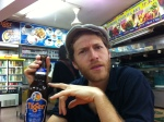 ollie fury drinking a tiger beer in singapore before performing at actors jam bar
