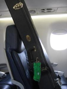 someone's guitar on a plane