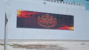 Big Texas BBQ ad on wall in Bahrain